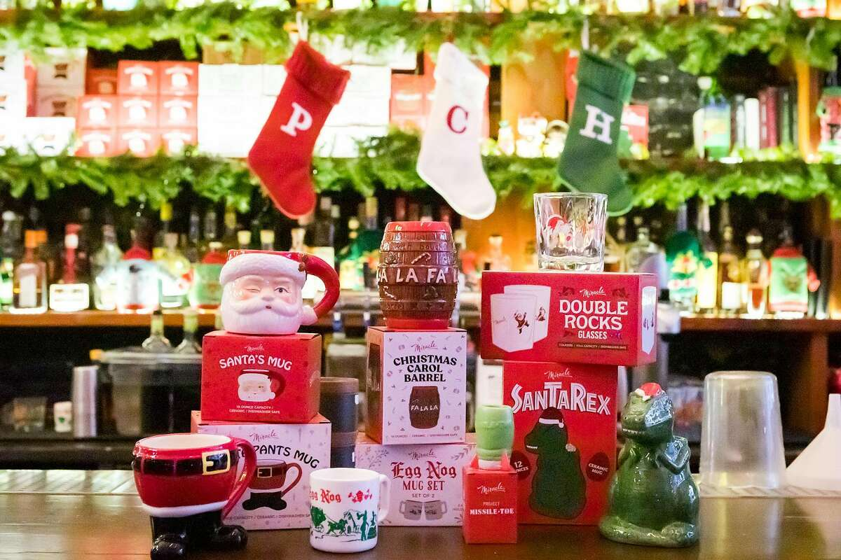 Some of the holiday-themed mugs and glasses available at the annual