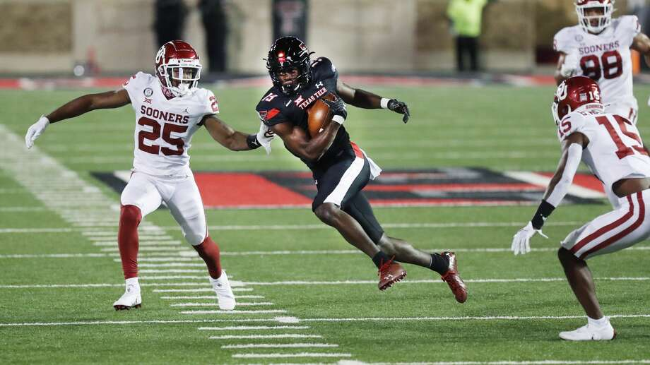 Texas Tech wide receiver Loic Fouonji carries the ball before being tackled by Oklahoma safety Justin Broiles during the second half of an NCAA college football game, Saturday, Oct. 31, 2020, in Lubbock, Texas. (AP Photo/Mark Rogers) / Copyright 2020 The Associated Press. All rights reserved