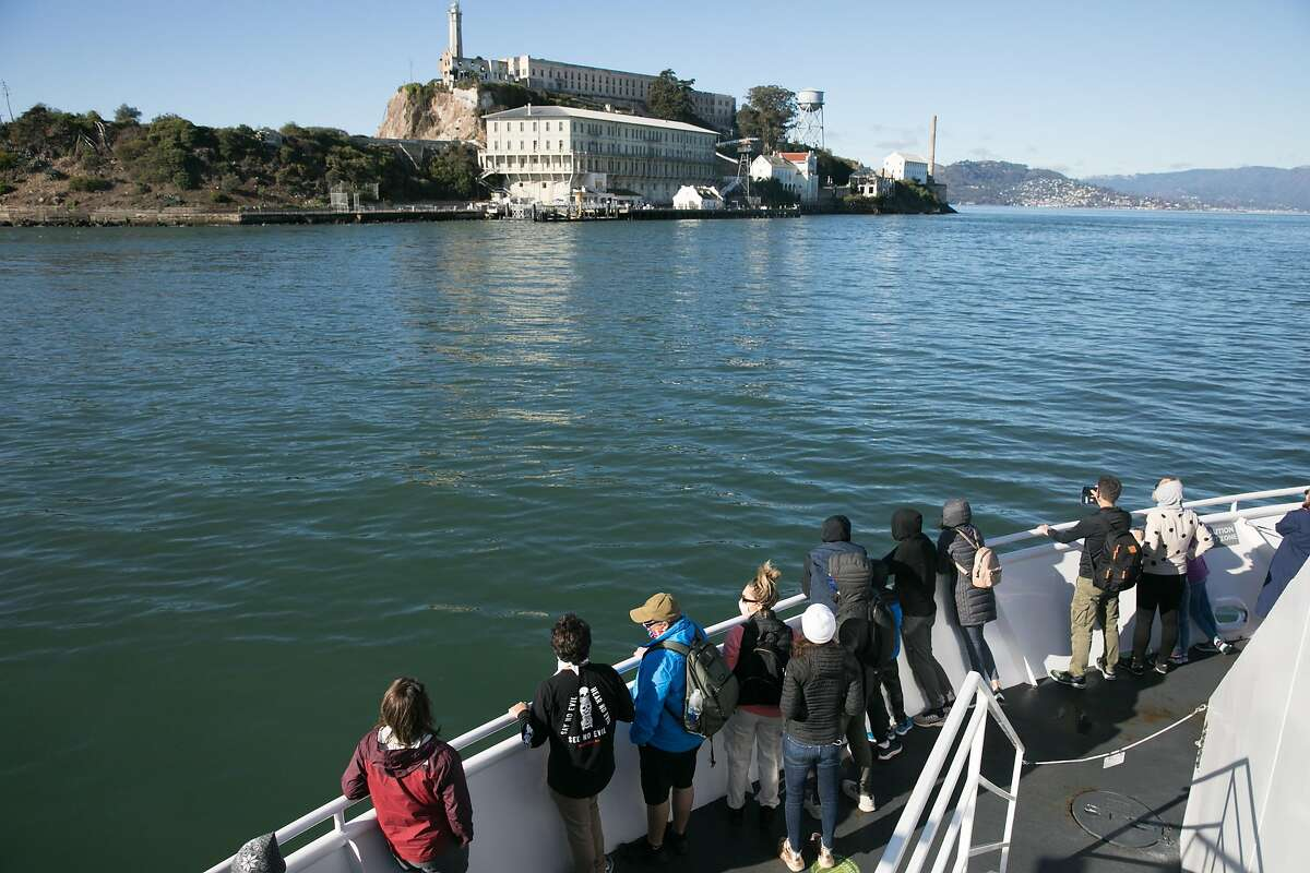 Visitors taking the ferry to visit Alcatraz Island in San Francisco on Nov. 23, 2020. For the past 17 years, the National Park Service and Golden Gate National Parks Conservancy have been uncovering and rehabilitating many gardens on the island that were created and maintained during its time as a military base and later a prison.
