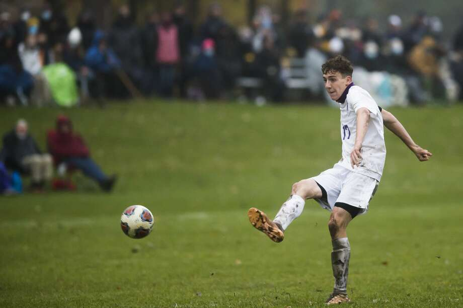 Calvary Baptist's Toby Stauffer takes a free kick in an Oct. 22, 2020 district final against Bad Axe. Photo: Daily News File Photo