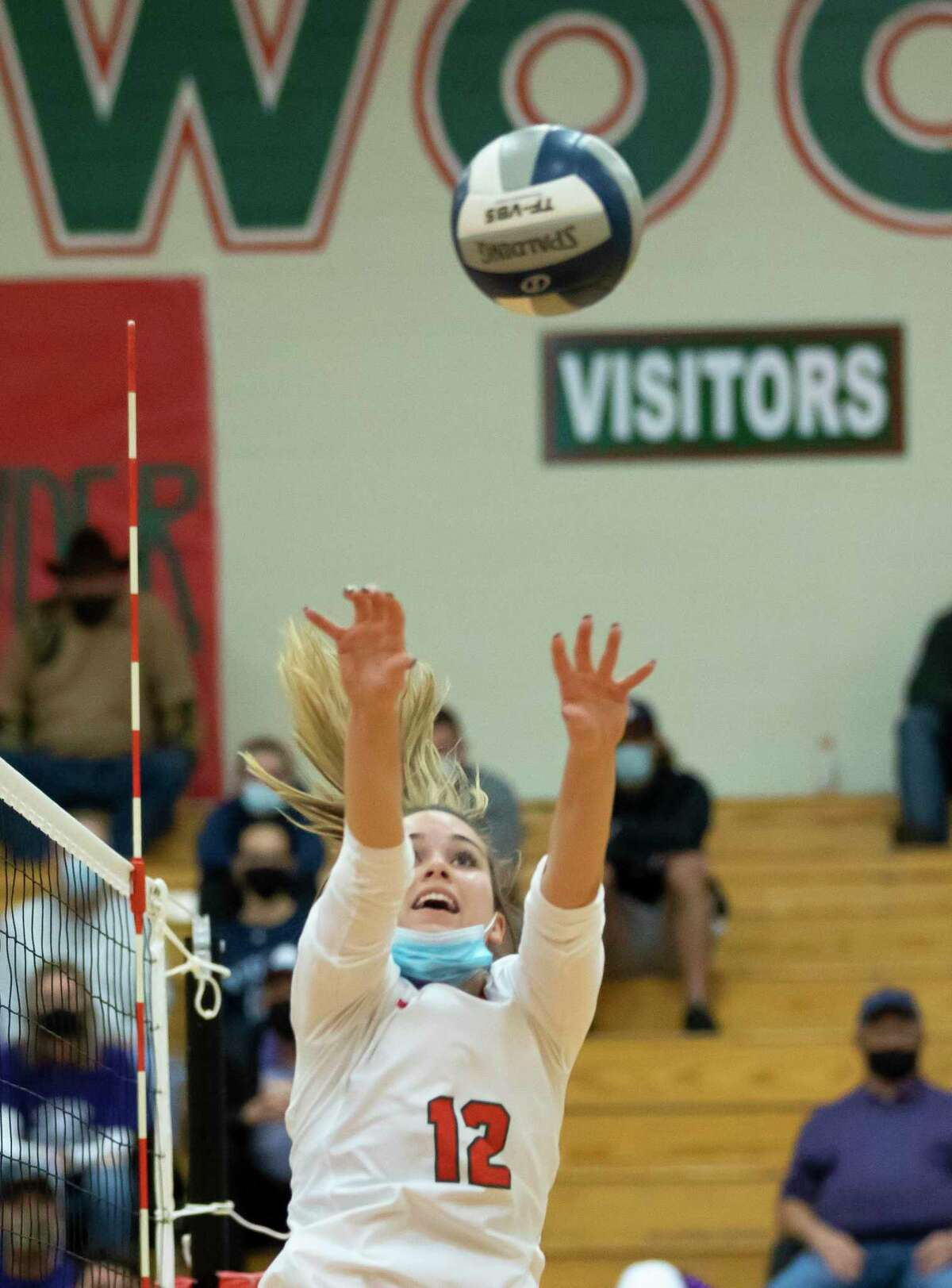 The Woodlands setter Clara Brower (12) sets a play during the first set of a Region II-6A quarterfinal volleyball playoff game against Klein Cain at The Woodlands High School, Saturday, Nov. 28, 2020, in The Woodlands.