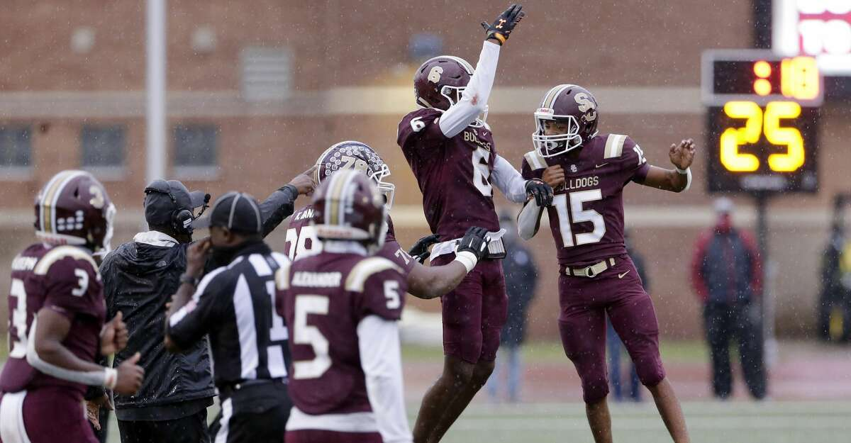 Sumner Creek's Roriyon Richardson (6) and Myles Thomas (15) jump in celebration after Thomas' interception in the final seconds, locking in their win over Humble during the second half of a high school football game at Turner Stadium Saturday, Nov. 28, 2020 in Humble, TX.