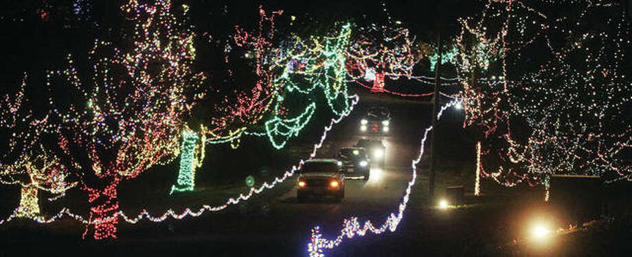 Cars head toward the exit of Christmas Wonderland, the annual holiday light display put on by the Grandpa Gang, at Alton's Rock Spring Park during opening night Friday. The display, which features approximately four million lights, continues through Dec. 27. Photo: Scott Cousins|The Telegraph