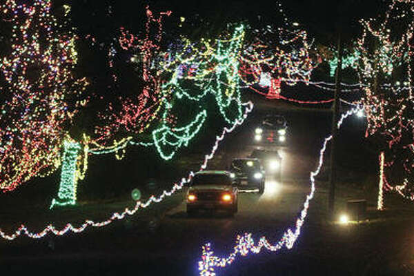 Cars head toward the exit of Christmas Wonderland, the annual holiday light display put on by the Grandpa Gang, at Alton's Rock Spring Park during opening night Friday. The display, which features approximately four million lights, continues through Dec. 27.