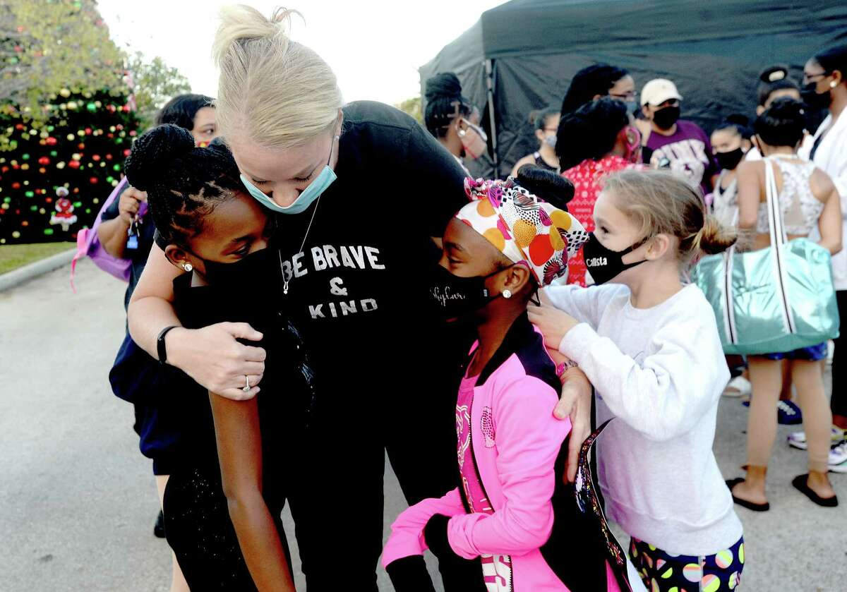 iRule Dance owner CharLee Hanna-Rule gets a hug from dancers during a final rehearsal before their Alter's tree lighting ceremony performance Wednesday night. Photo taken Wednesday, November 25, 2020 Kim Brent/The Enterprise