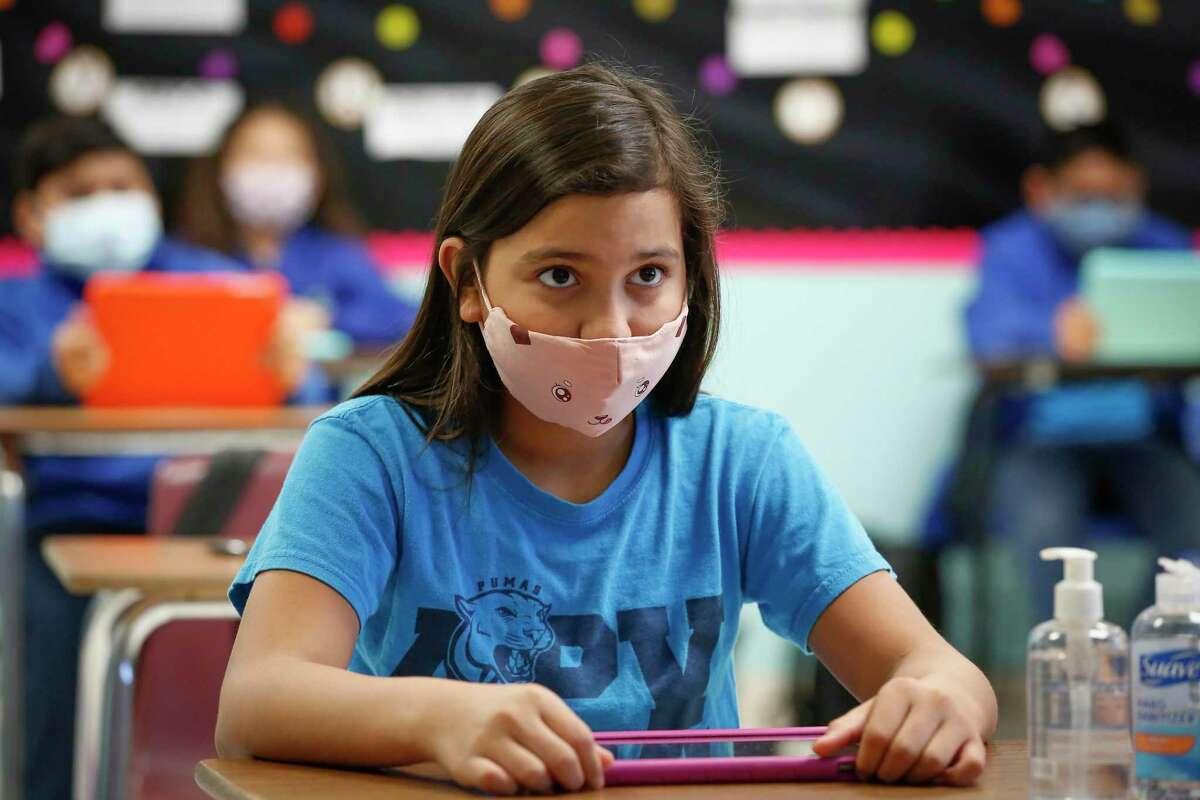 Amigos Por Vida-Friends For Life Public Charter School 5th-grader Brittany Lagos takes part in a class quiz in Ms. Esna Zamora's class Friday, Nov. 20, 2020, in Houston.