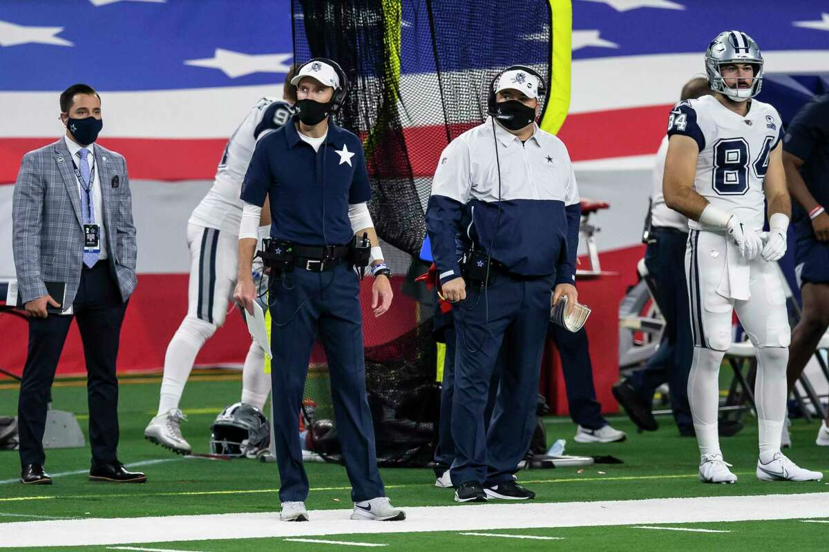 Dallas Cowboys special teams coach John Fassel, center left, and head coach Mike McCarthy, center right, look on during an NFL football game against the Washington Football Team, Thursday, Nov. 26, 2020, in Arlington, Texas. Washington won 41-16. (AP Photo/Brandon Wade)