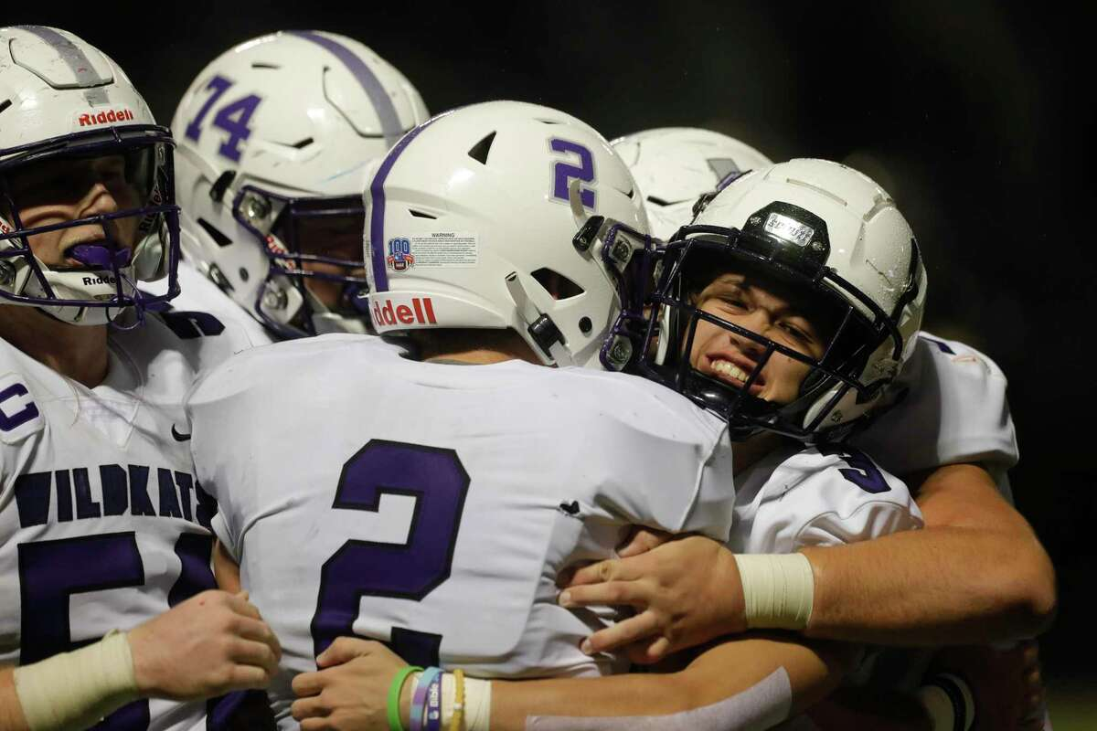 Willis quarterback Steele Bardwell (2) is mobbed by teammates after scoring the go-ahead two-point conversion during the fourth quarter of a District 13-6A high school football game at Buddy Moorhead Stadium, Saturday, Nov. 28, 2020, in Conroe. Willis defeated Conroe 29-28 to earn the district's final playoff spot and reach the post-season for the first time since 2016.