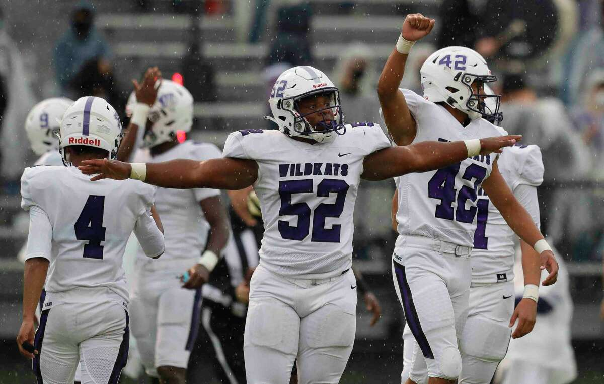 Willis defensive linemen Eli'jah Hubbard (52) and defensive linemen David Soriano (42) react after stopping Conroe short on third down during the first quarter of a District 13-6A high school football game at Buddy Moorhead Stadium, Saturday, Nov. 28, 2020, in Conroe.