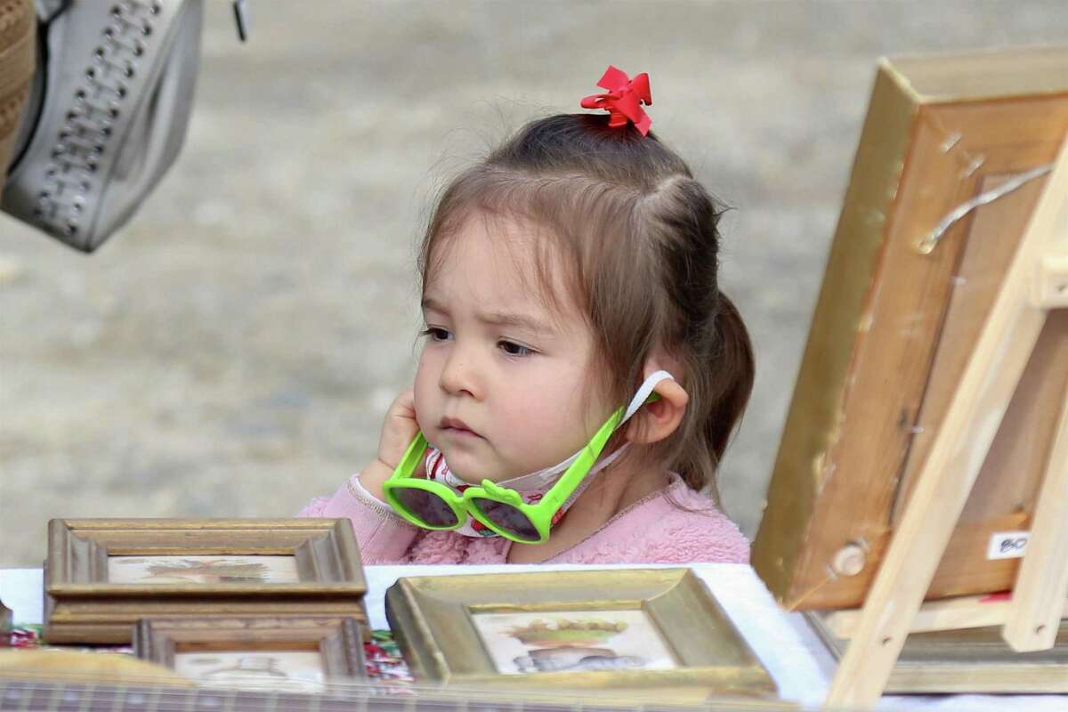 Ava Wilkinson, 2, of Weston, looks over the merchandise at the Norfield Grange's Black Friday Trunk Sale on Nov. 27, 2020, in Weston, Conn.