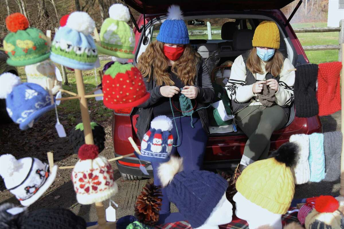 Artists Catherine, left, and Anna Kimberly of Weston-based Sissie Knits work on their product at the Norfield Grange's Black Friday Trunk Sale on Nov. 27, 2020, in Weston, Conn.