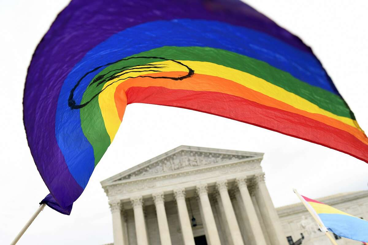 The Biden administration needed only a few hours in office to send the message that the Supreme Court last summer had issued a landmark decision protecting millions of LGBTQ people and the government would do everything it could to carry it out.