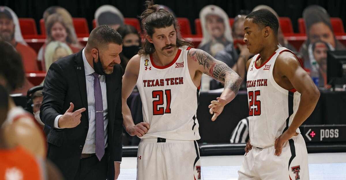 Texas Tech coach Chris Beard talks to Avery Benson (21) and Nimari Burnett (25) during the second half of an NCAA college basketball game Friday, Nov. 27, 2020, in Lubbock, Texas. (AP Photo/Brad Tollefson)