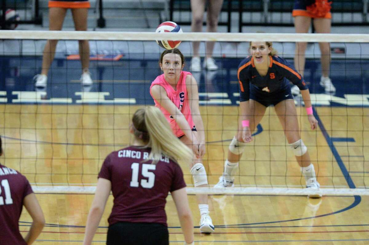 Libero Kailey Bickel (1) of Seven Lakes digs for a ball during the fourth set of a 6A-III regional quarterfinal game between the Cinco Ranch Cougars and the Seven Lakes Spartans on Saturday, November 28, 2020 at Leonard Merrell Center, Katy, TX.