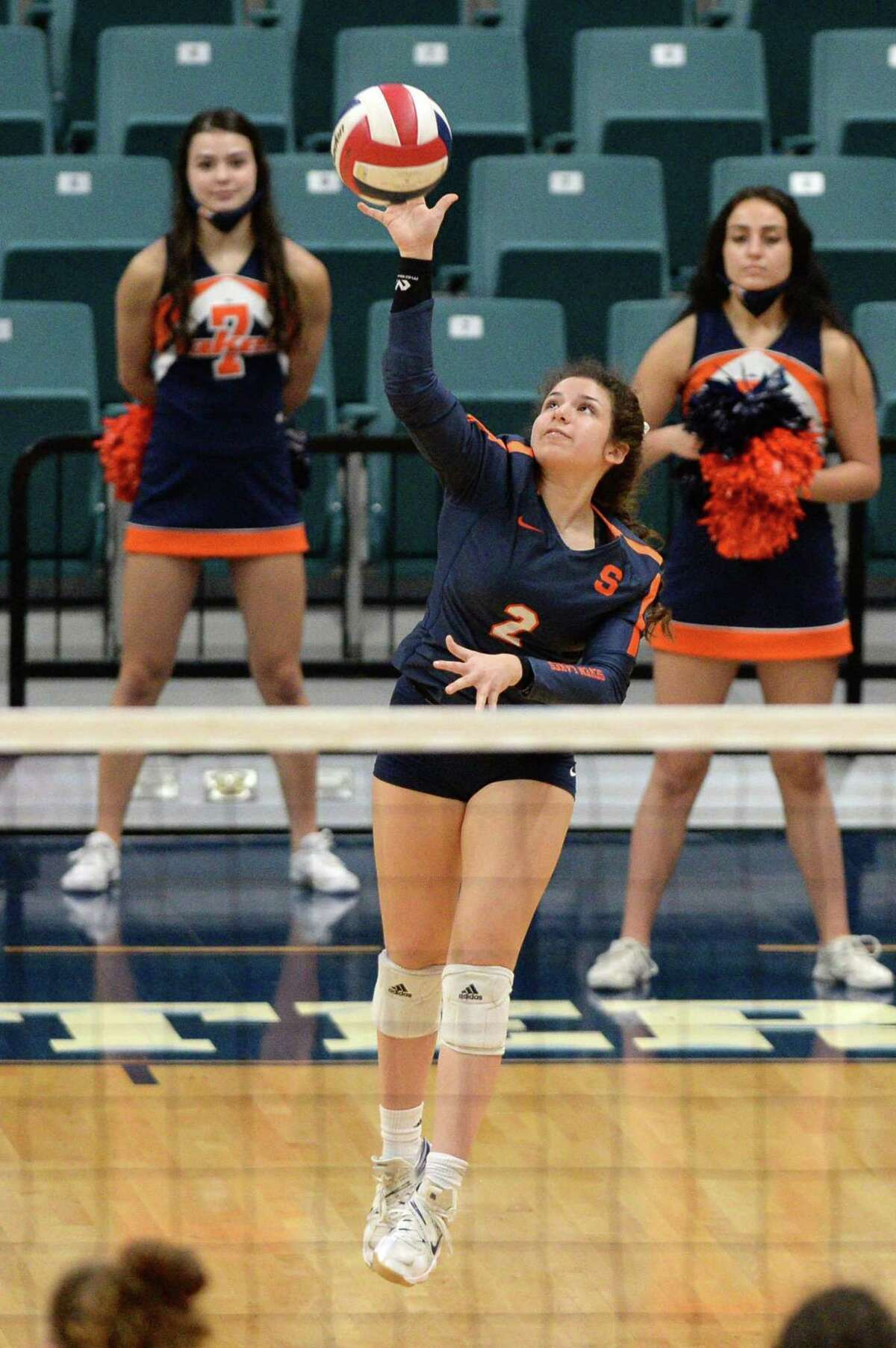Grace Lanier (2) of Seven Lakes serves during the fourth set of a 6A-III regional quarterfinal game between the Cinco Ranch Cougars and the Seven Lakes Spartans on Saturday, November 28, 2020 at Leonard Merrell Center, Katy, TX.