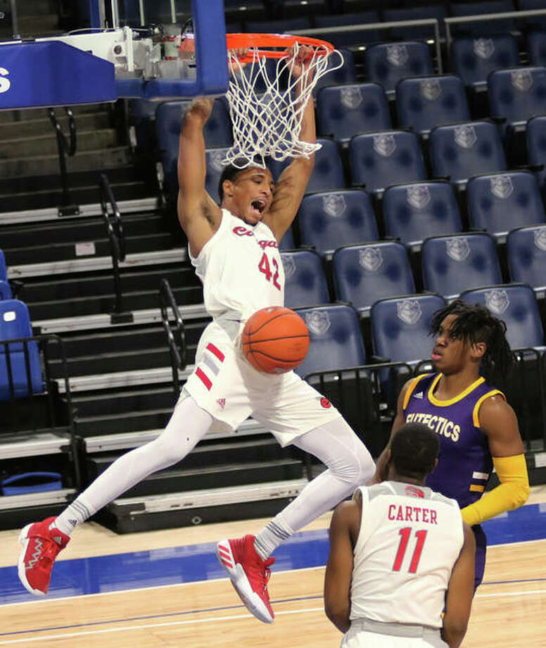 SIUE's Shamar Wright reacts after throwing down a dunk after beating UHSP's Jason Udolisa and SIUE's Courtney Carter (11) to the basket in the first half Saturday night during the Billiken Classic at Chaifetz Center in St. Louis. Photo: Greg Shashack / The Telegraph