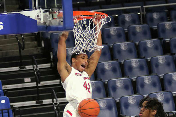 SIUE's Shamar Wright reacts after throwing down a dunk after beating UHSP's Jason Udolisa and SIUE's Courtney Carter (11) to the basket in the first half Saturday night during the Billiken Classic at Chaifetz Center in St. Louis.