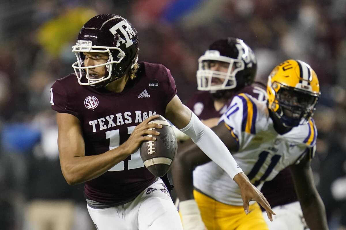 Texas A&M quarterback Kellen Mond (11) is chased out of the pocket by LSU defensive lineman Ali Gaye (11) during the first quarter of an NCAA college football game, Saturday, Nov. 28, 2020. in College Station, Texas. (AP Photo/Sam Craft)
