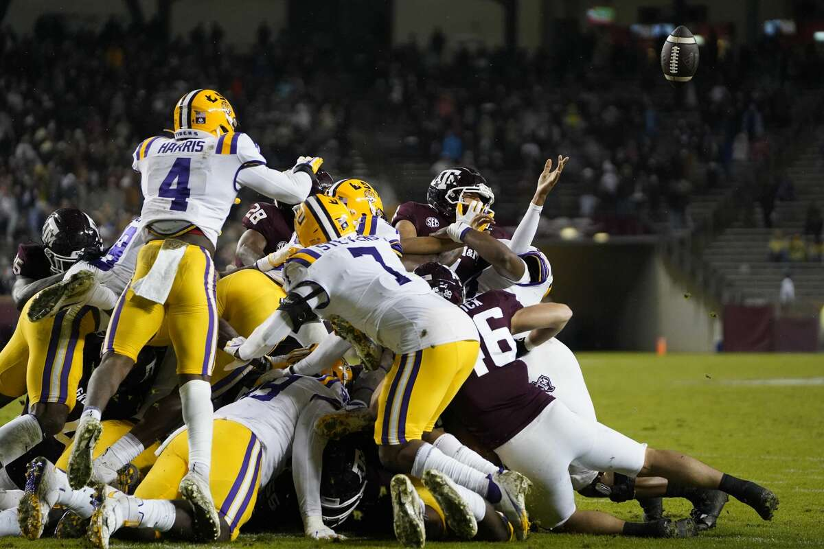 Texas A&M quarterback Kellen Mond (11) has the ball knocked out of his hands by LSU on a fourth-down play during the second quarter of an NCAA college football game Saturday, Nov. 28, 2020. in College Station, Texas. (AP Photo/Sam Craft)