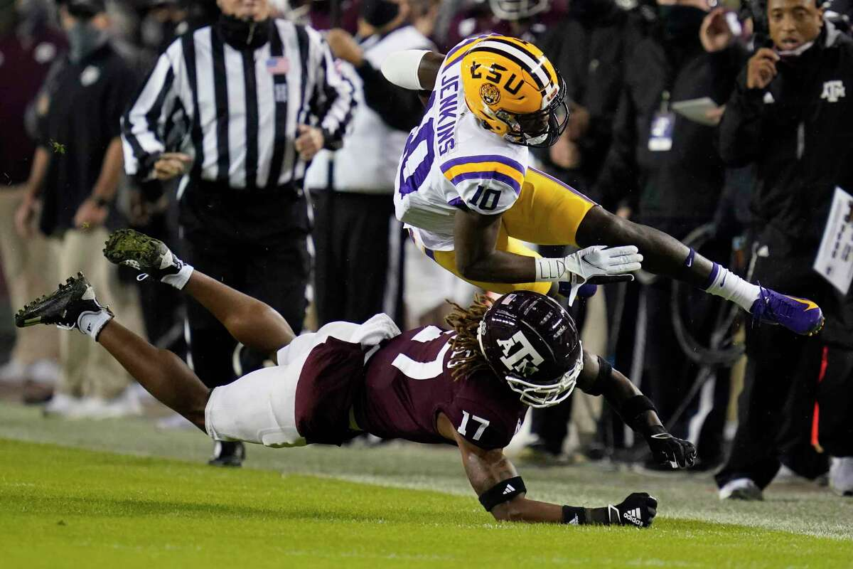 Texas A&M defensive back Jaylon Jones (17) cuts out the legs of LSU wide receiver Jaray Jenkins (10) during the first half of A&M's victory on Saturday.