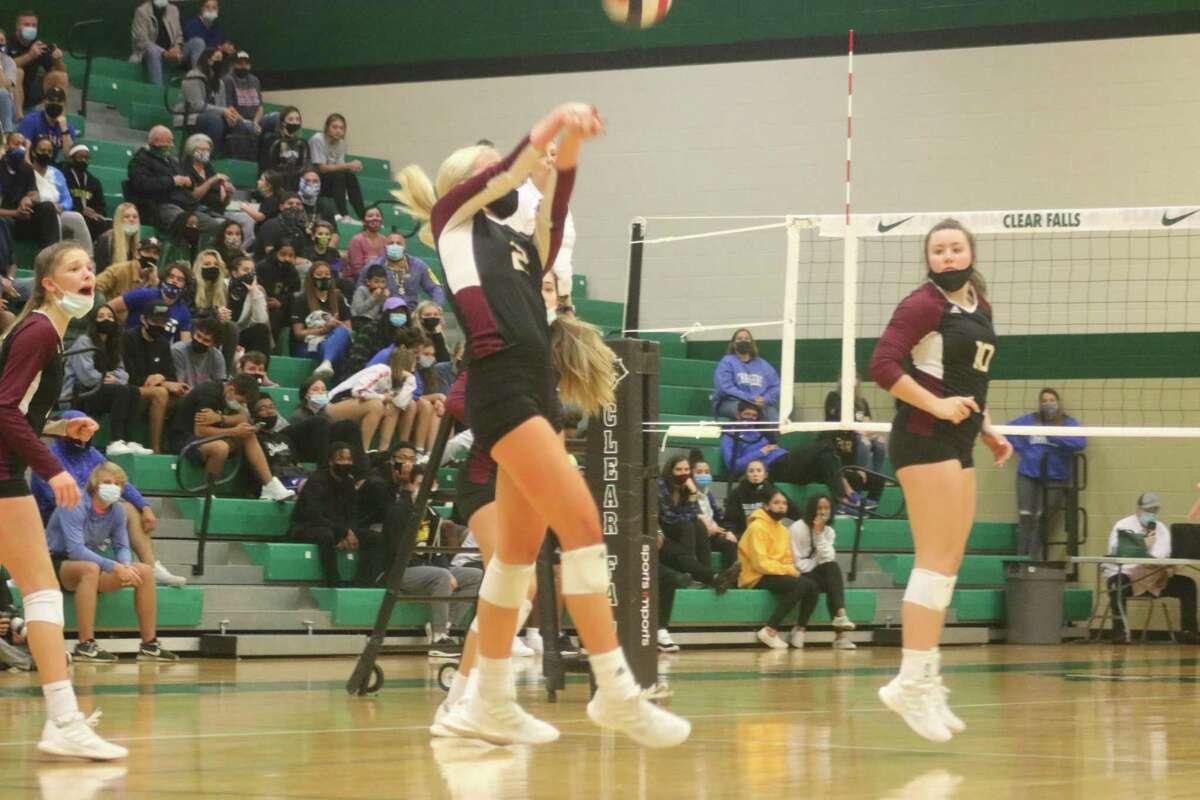 Phoebe Stigen serve-receives a ball during Saturday's regional quarterfinal match at Clear Falls High School. Stigen finished with a team-high 16 kills.