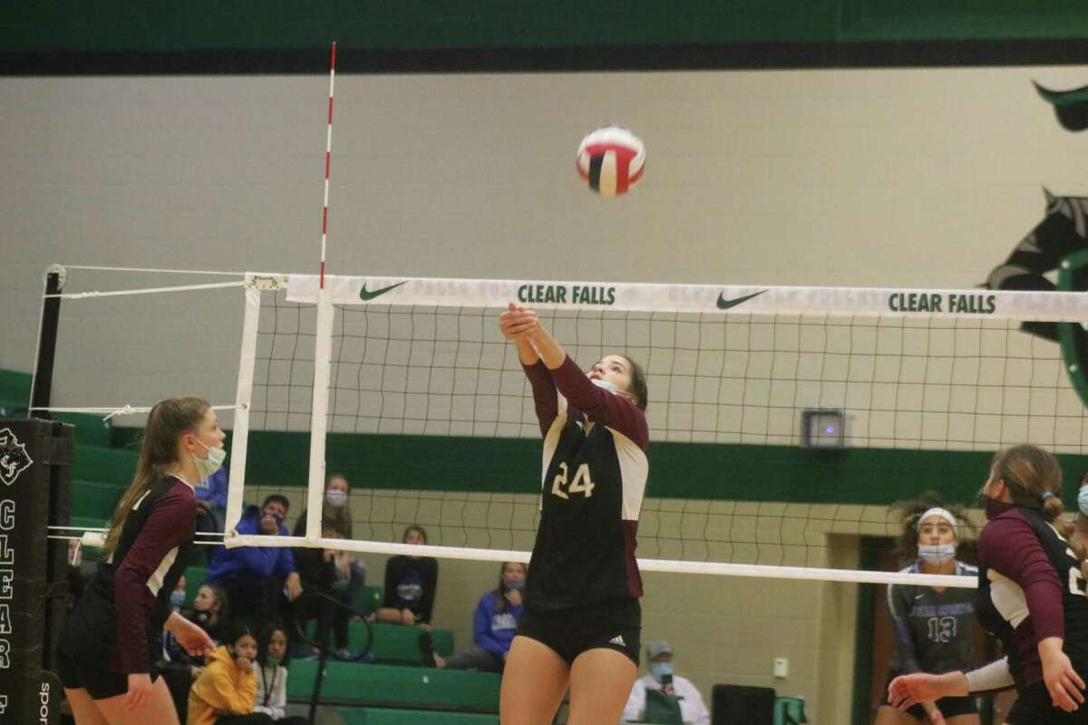Cayley Hanson bumps the ball over the net during the latter stages of Saturday's match.