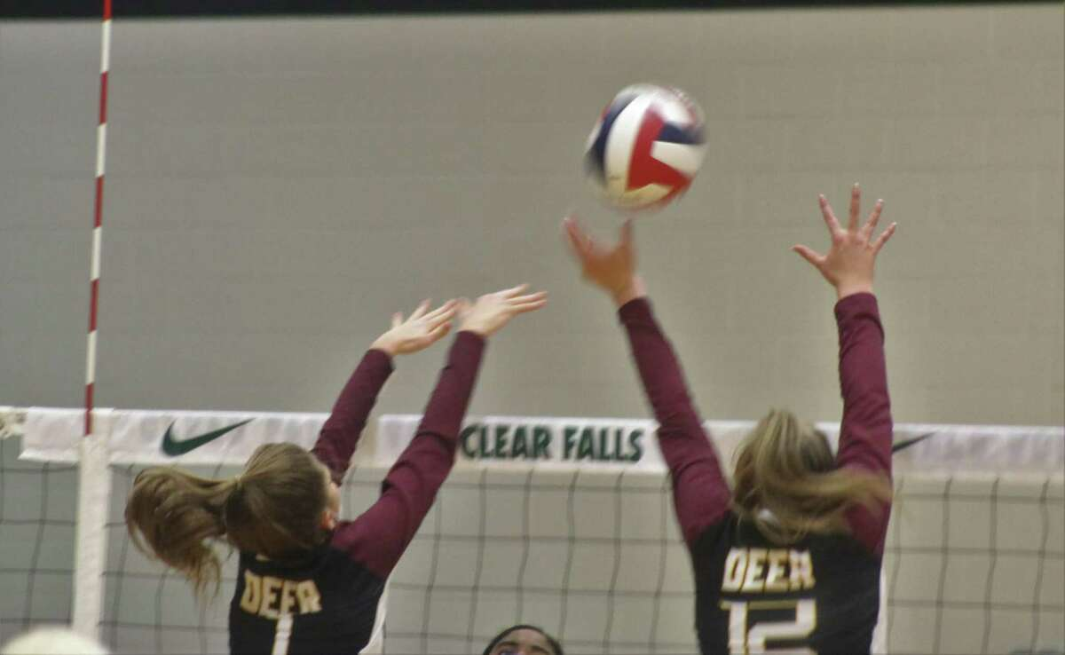 Tatum Busch (1) blocks a Clear Springs kill attempt as she's joined at the net by Ella Gilbert.