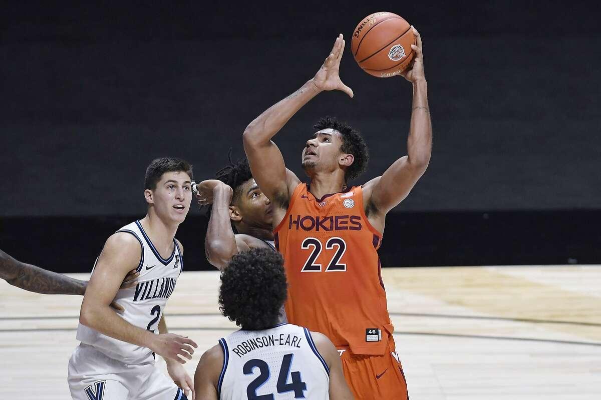 Virginia Tech's Keve Aluma goes up for a shot as Villanova's Collin Gillespie (left) and Jeremiah Robinson-Earl watch.