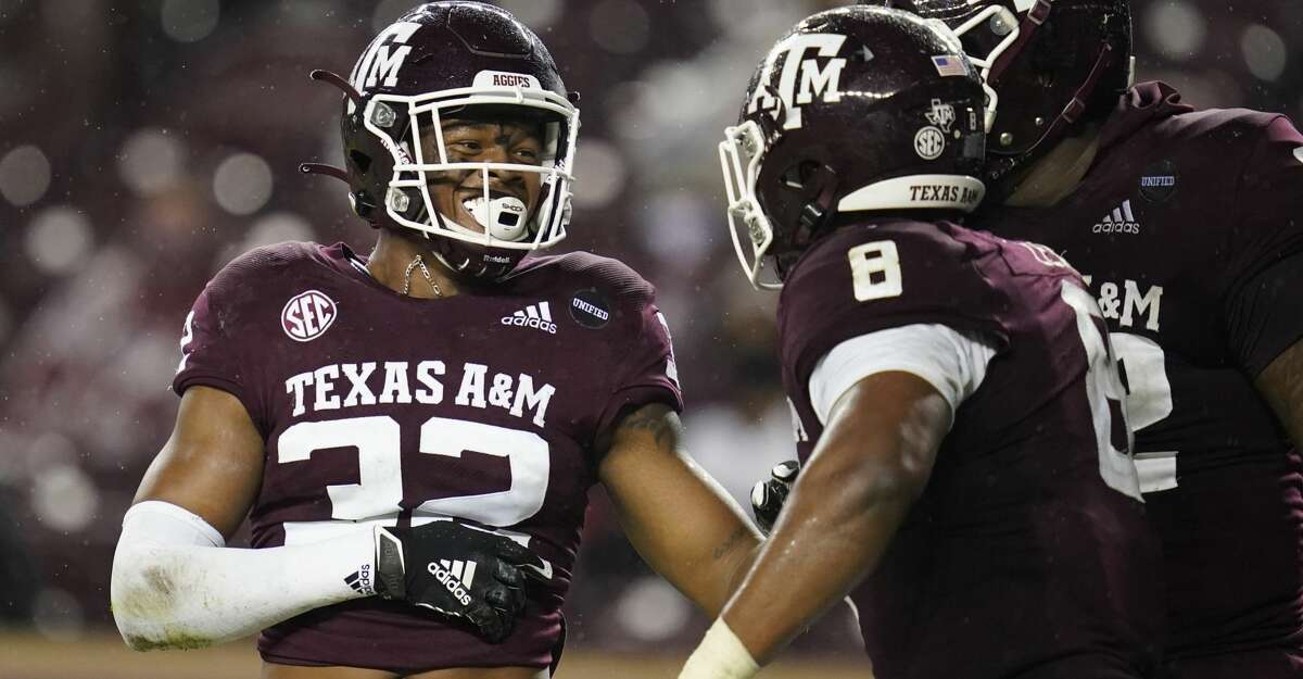 Texas A&M linebacker Andre White Jr. (32) smiles to teammates after sacking LSU quarterback Max Johnson during the third quarter of an NCAA college football game Saturday, Nov. 28, 2020, in College Station, Texas. (AP Photo/Sam Craft)