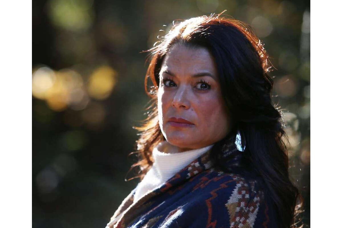 Charlene Nijmeh, chair of the Muwekma Ohlone tribe in the Bay Area, stands for a portrait next to Strawberry Creek on the UC Berkeley campus on Friday, November 27, 2020 in Berkeley, Calif.