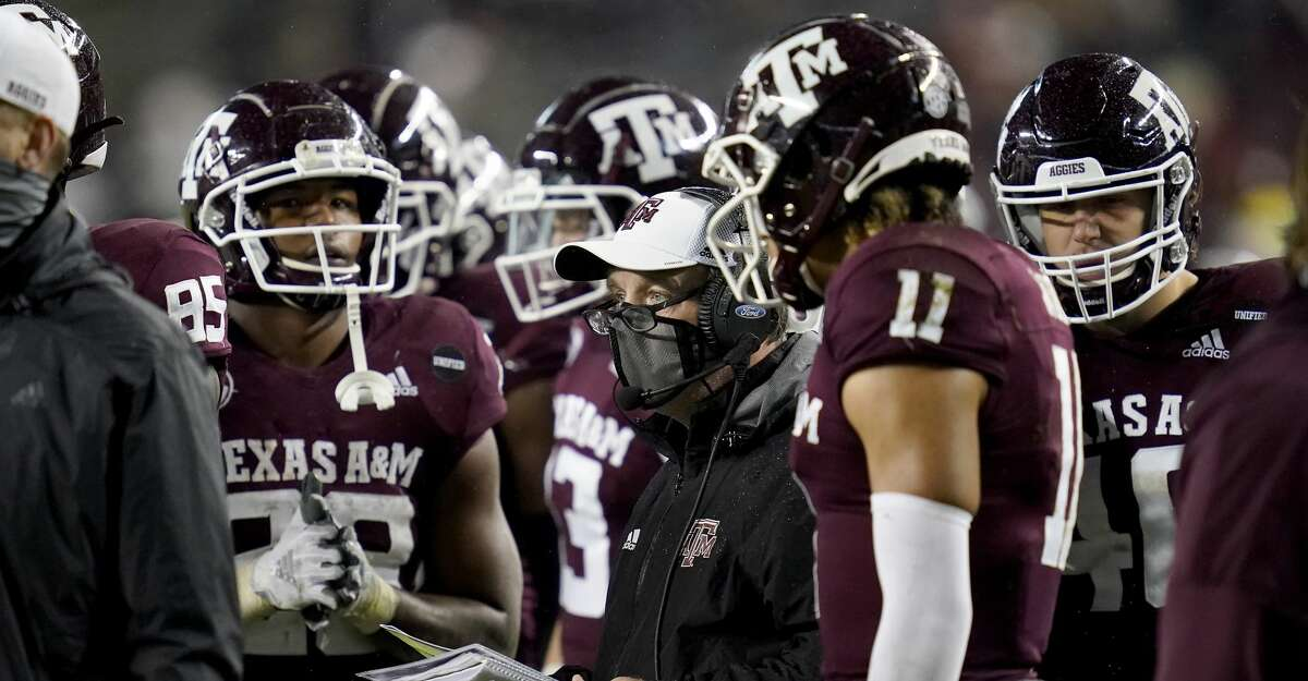 Texas A&M head coach Jimbo Fisher talks to his team during a timeout of an NCAA college football game against LSU, Saturday, Nov. 28, 2020. in College Station, Texas. (AP Photo/Sam Craft)