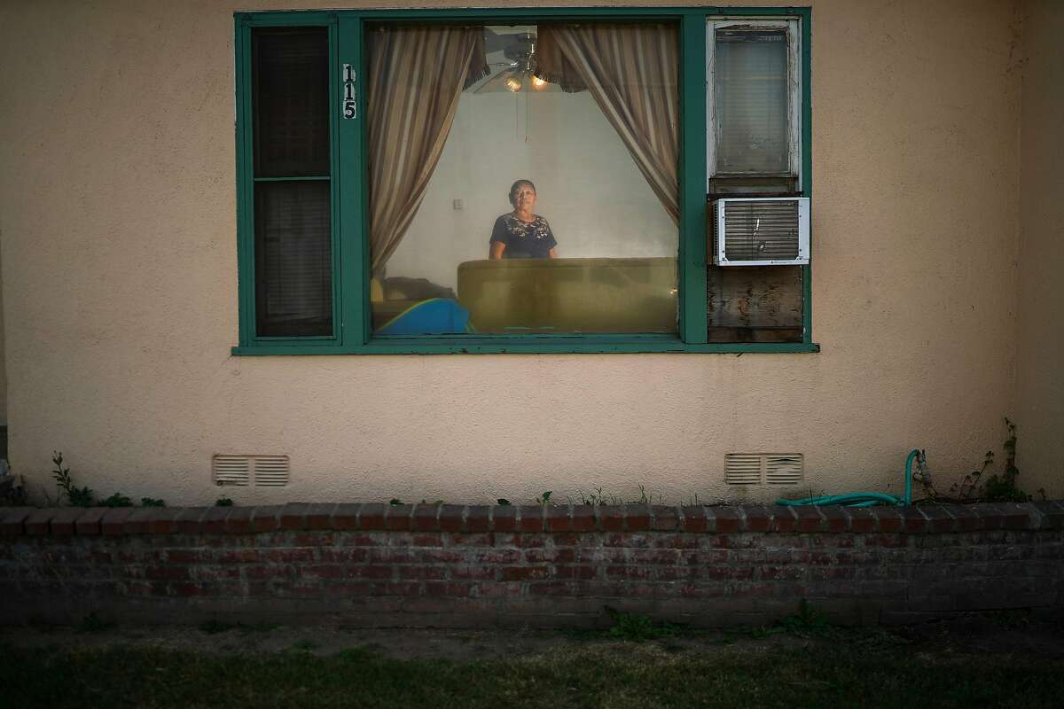 Martha Calleres, who is a grandmother of two asthmatic children, inside her home in Reedley, Calif., on Oct. 22, 2020. Fires are making California's air more dangerous. How much that hurts depends largely on where you live and how much money your family has. (Chang W. Lee/The New York Times)