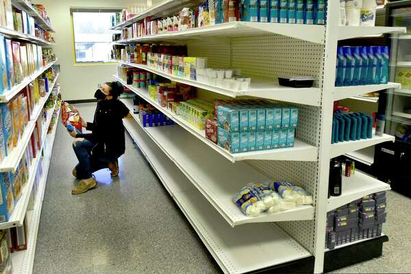 Southern Connecticut State University sophomore Abby Przybylowicz, a Federal Work Study student who works in the SCSU student food pantry scheduling appointments for students to pick up food, organizes shelves of food, uses Instagram as an outreach for the food pantry and helps train other students to work in the pantry.