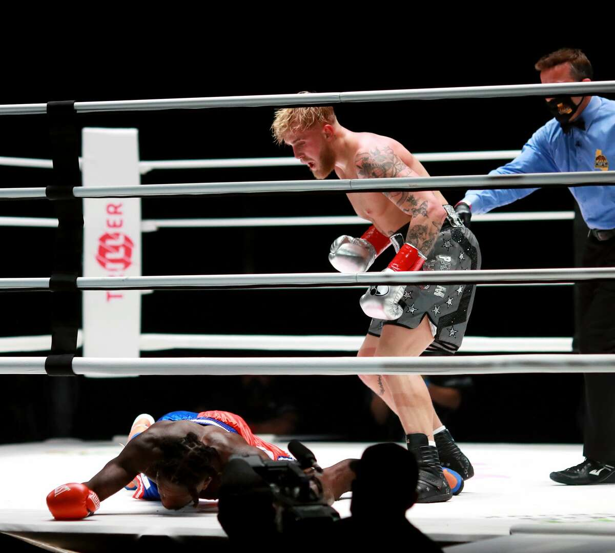 Jake Paul reacts over his knockout victory against Nate Robinson in the second round during Mike Tyson vs Roy Jones Jr. presented by Triller at Staples Center on November 28, 2020 in Los Angeles.