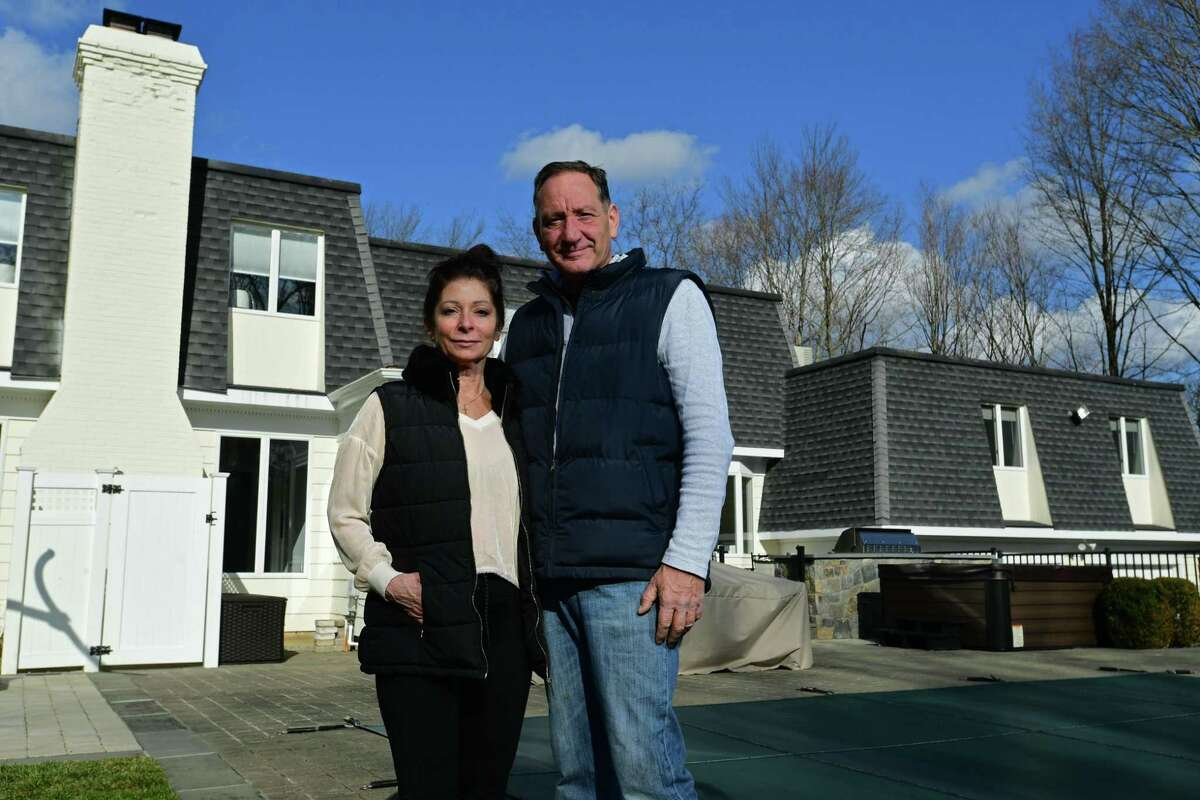 Bill Riehl and his girlfriend Janic Heusser at his home Saturday, November 28, 2020, in Stamford, Conn. Riehl is one of the hundreds of New Yorkers who have moved to Stamford since the pandemic hit the tri-state area in March.