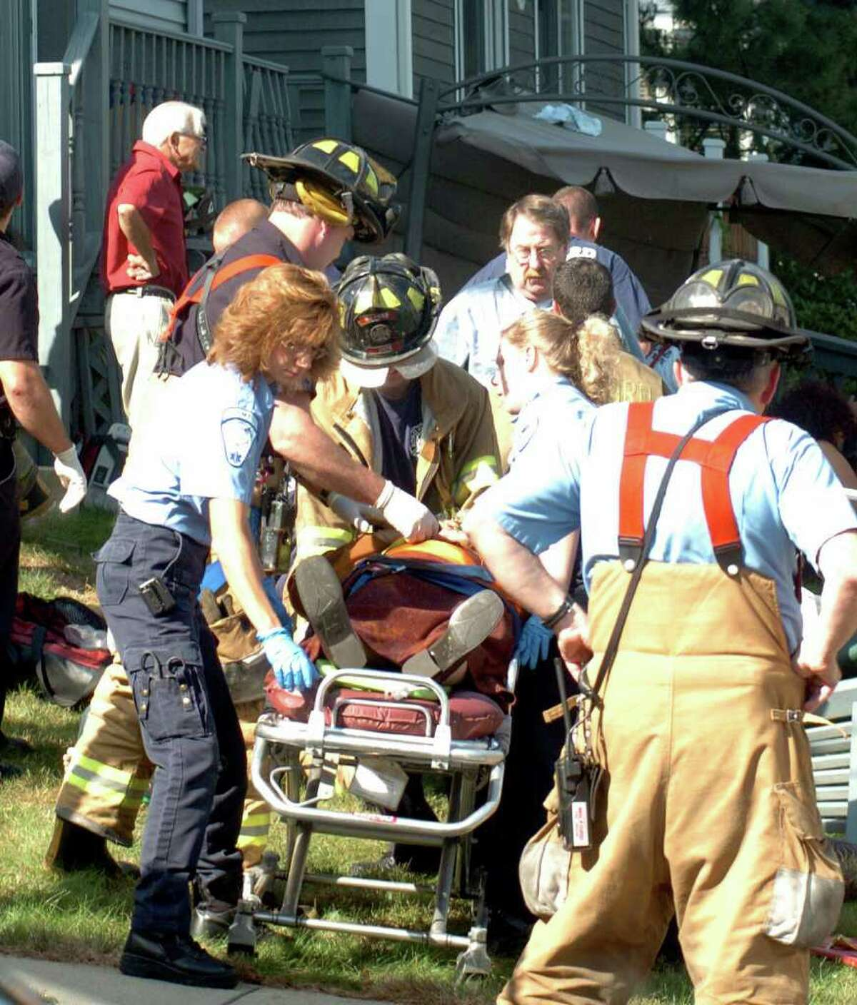 The scene after a deck collapsed at 25 Gillette St. in Milford, Conn. on Sept. 26th, 2004.