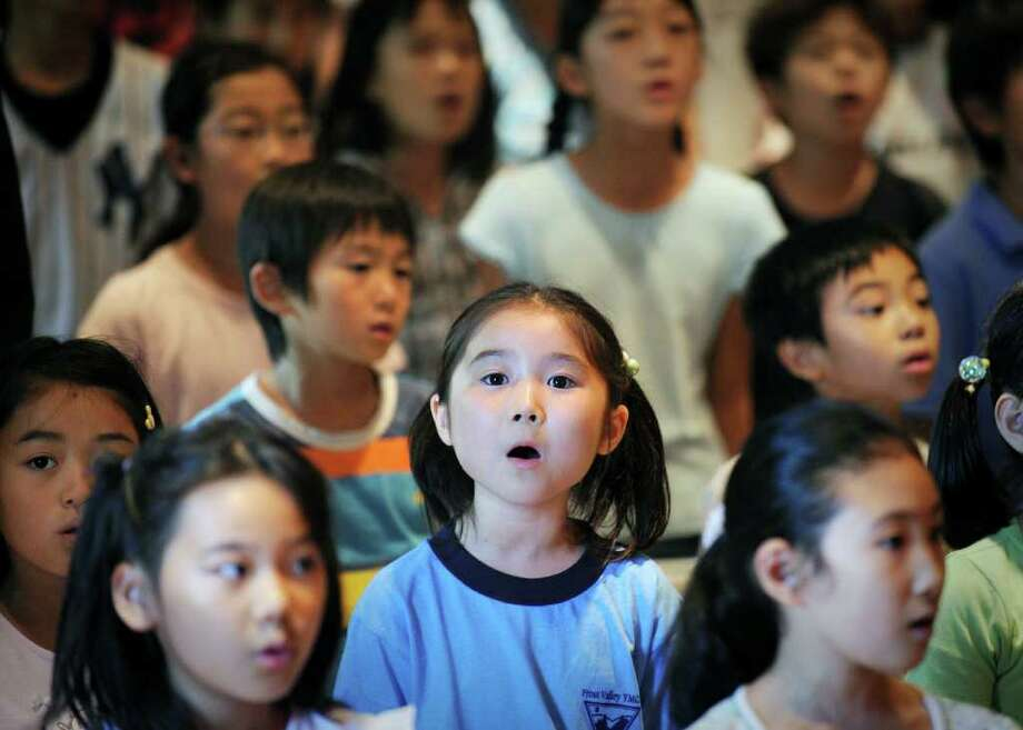 Japanese School student, Mayu Nakagawa, 7, sings the Japanese National Anthem during the founding celebration of the Japanese School of New York, located on Lake Avenue in Greenwich, Thursday afternoon, Sept. 2, 2010.  The school celebrated its 35th anniversary. Photo: Bob Luckey / Greenwich Time