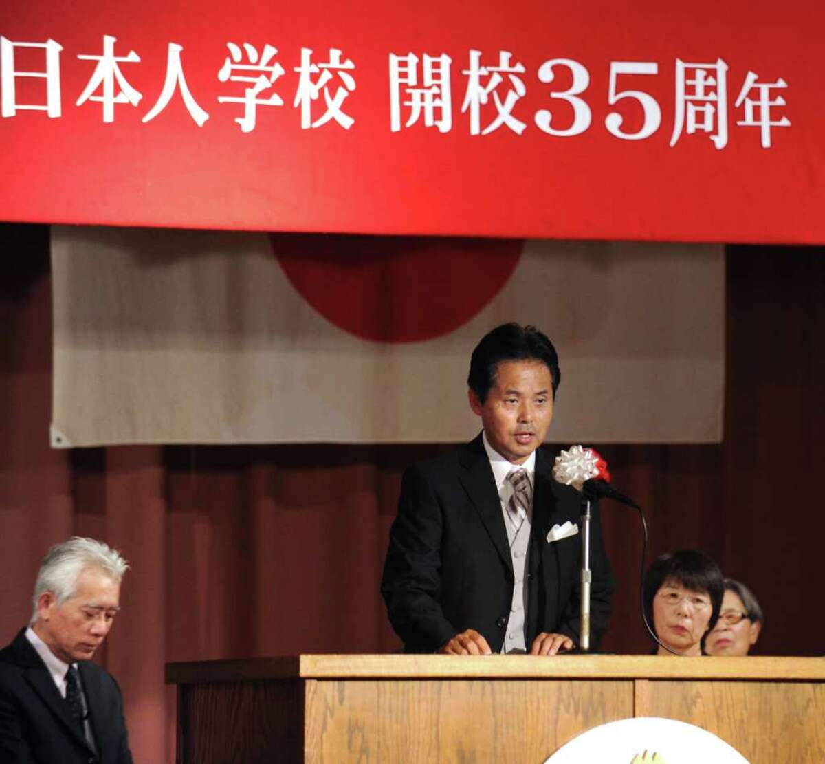 Tomoyuki Mitsui, center, principal of the Japanese School of New York located on Lake Avenue, Greenwich, addresses the audience during the celebration of the 35th anniversary of the school's founding, at the school, Thursday. Sept. 2, 2010.