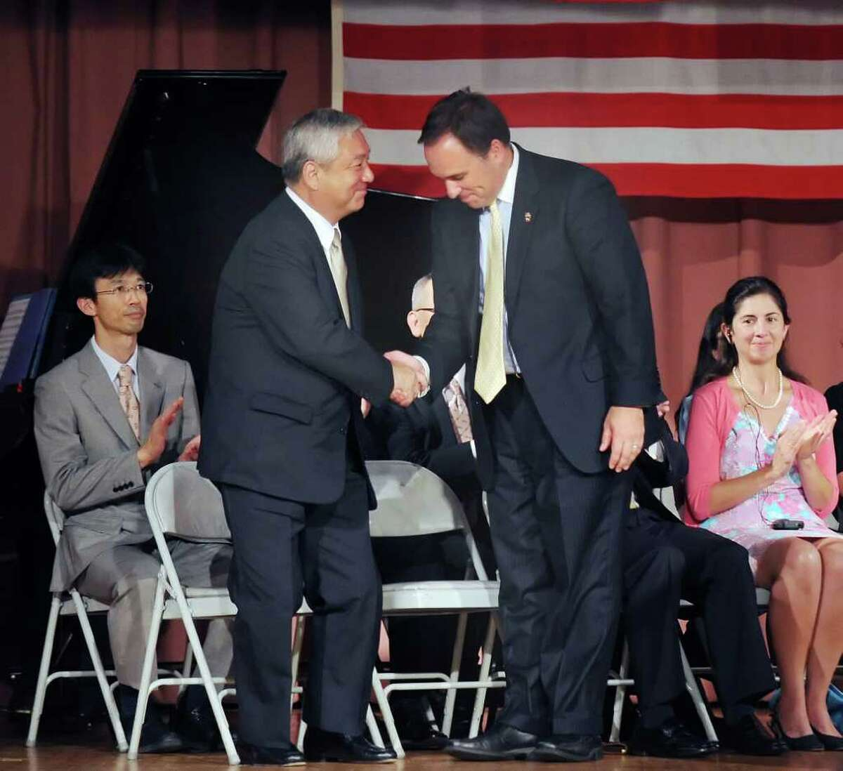 Japanese Ambassador to the United States Shinichi Nishimiya greets Greenwich First Selectman Peter Tesei during the 35th anniversary celebration of the foudning of the Japanese School of New York which is located on Lake Avenue, Greenwich, Thursday afternoon, Sept. 2, 2010.