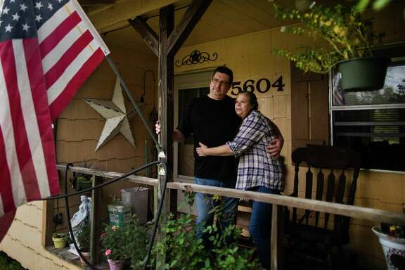 Craig Olds, 50, embraces his wife Lynn Olds, 52, at their home, Tuesday, Nov. 24, 2020, in Baytown. Craig is one of the millions of Americans who lost his job during the pandemic, and is trying to figure out how to support his family and find a job in a loose labor market.