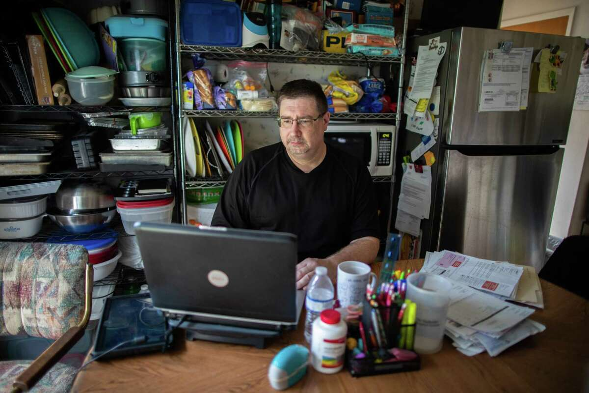 Craig Olds, 50, spends time on his computer Tuesday, Nov. 24, 2020, at his home in Baytown searching for a new job. Olds is one of millions of Americans who lost his job during the pandemic, and is trying to figure out how to support his family and find a job in a loose labor market.