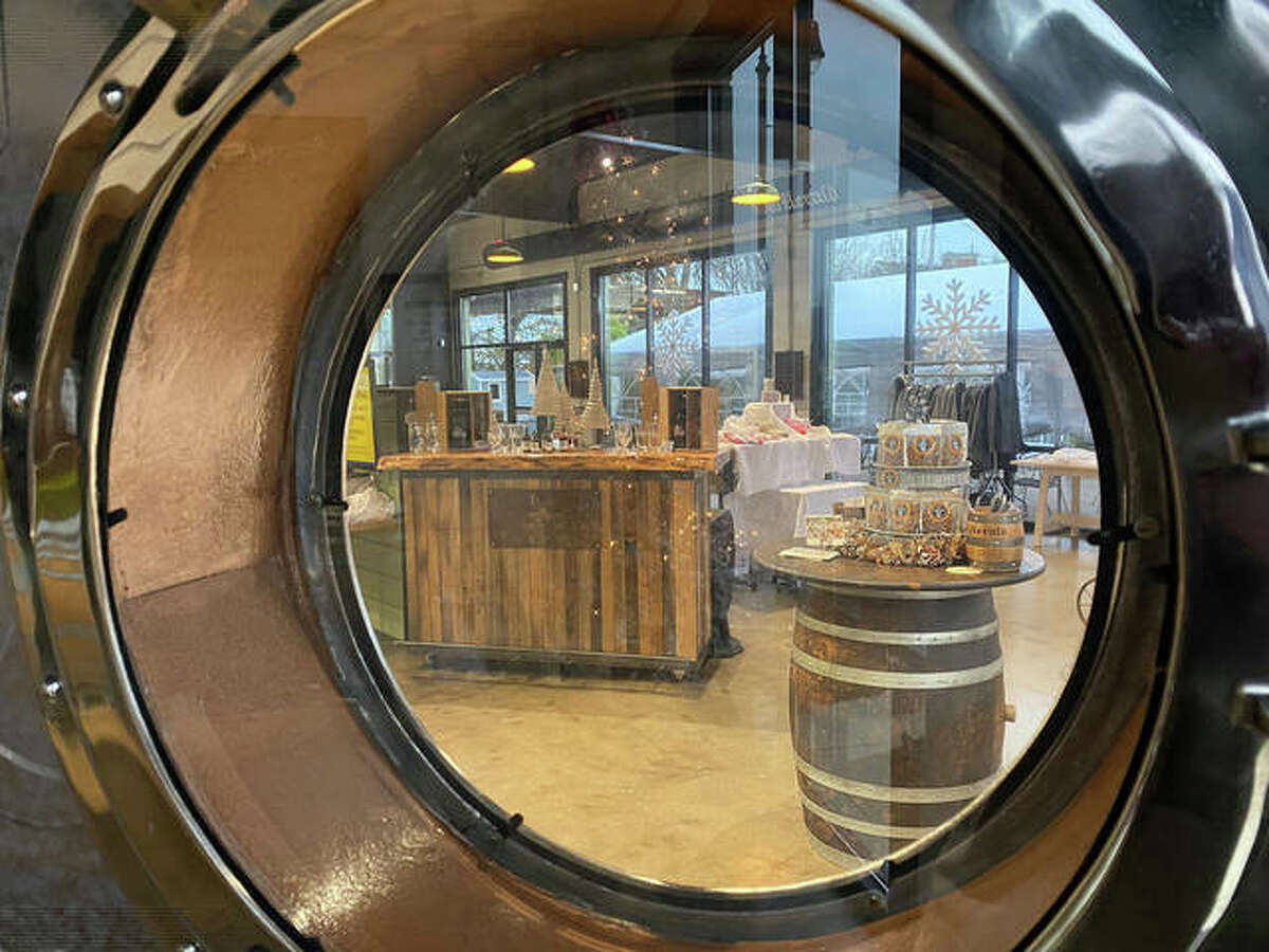 With no indoor dining due to COVID restrictions, the Old Herald Brewery & Distillery in Collinsville has temporarily converted its bar and dining room into a holiday market featuring some of its customers' favorite food and drink items.