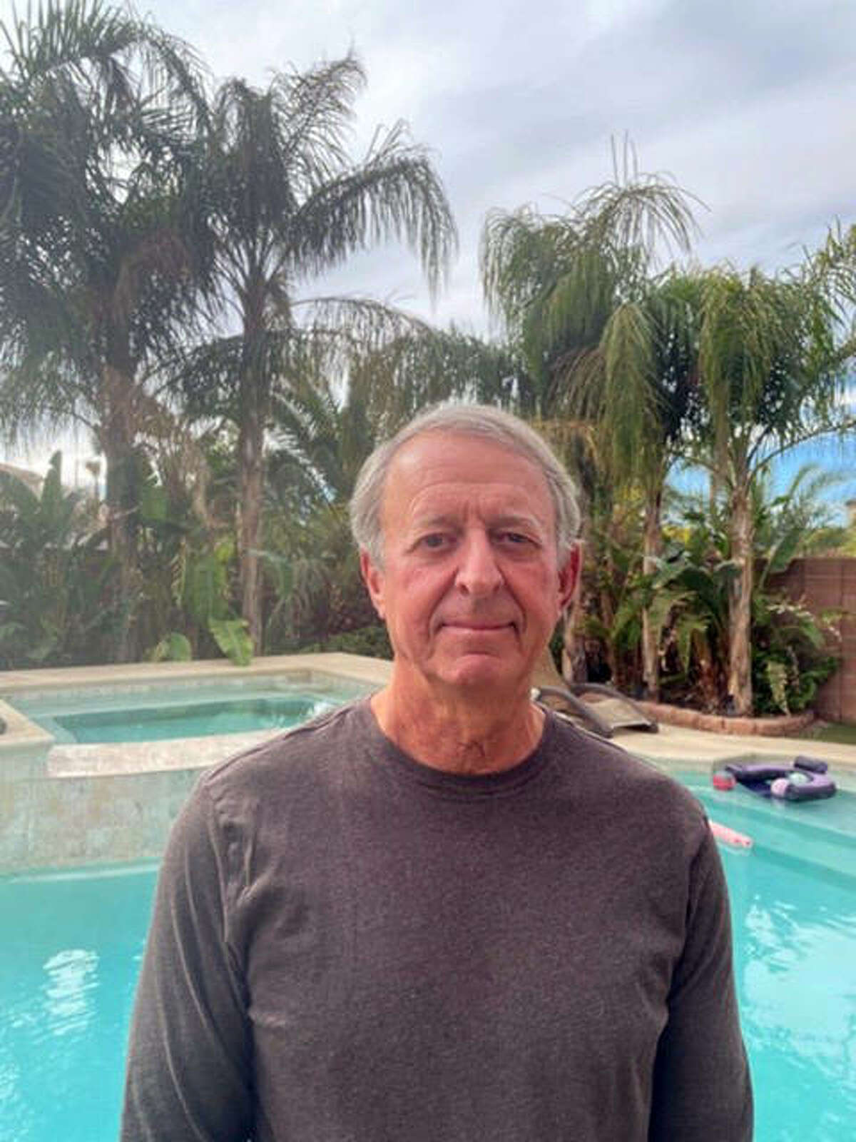 Former Glen Carbon Treasurer Larry Lucy poolside Monday at his winter home in Las Vegas, Nevada.