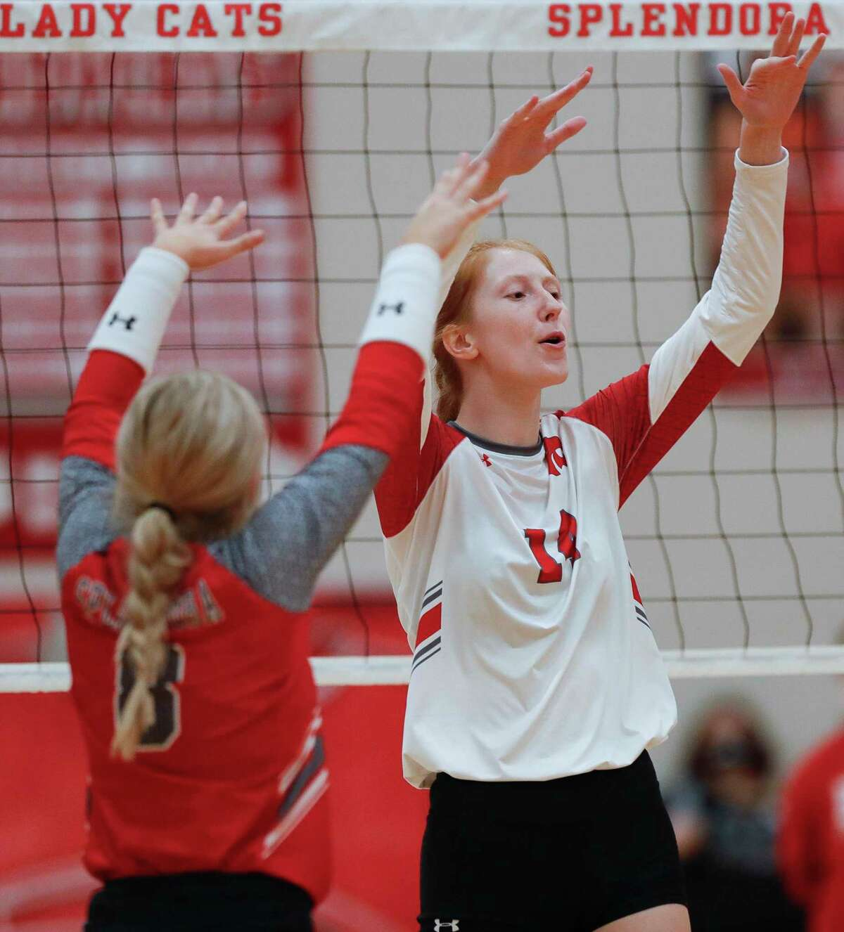 Splendora middle blocker Jalynn Knight (14) reacts after blocking a shot during the third set of a non-district high school volleyball match at Splendora High School, Tuesday, Aug. 18, 2020, in Splendora.