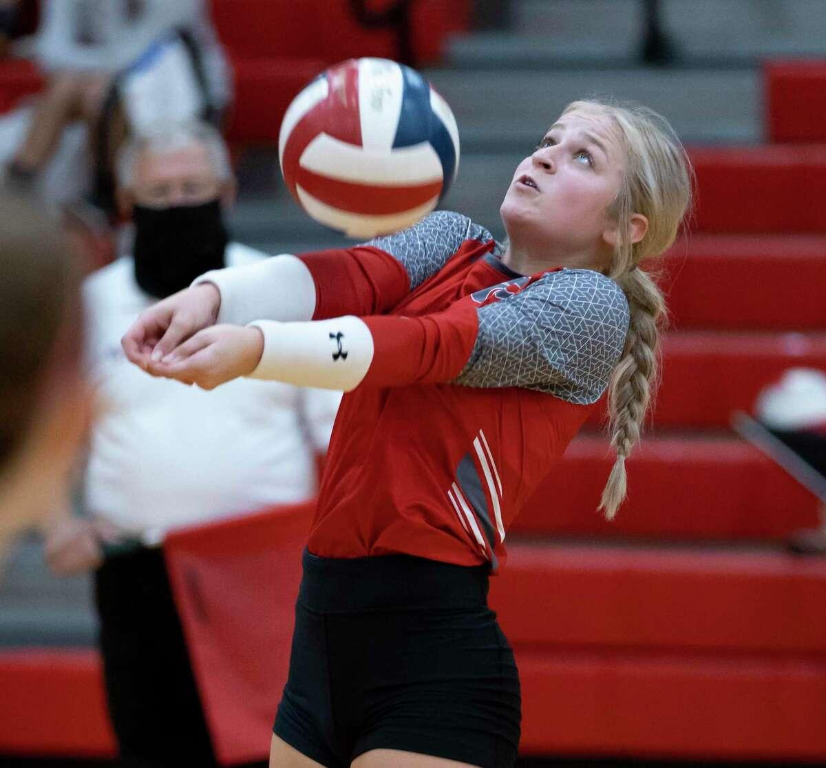 Splendora libero Ashton Schulz (8) returns a serve during the first set of a District 21-4A volleyball match at Splendora High School, Friday, Sept. 11, 2020, in Splendora.
