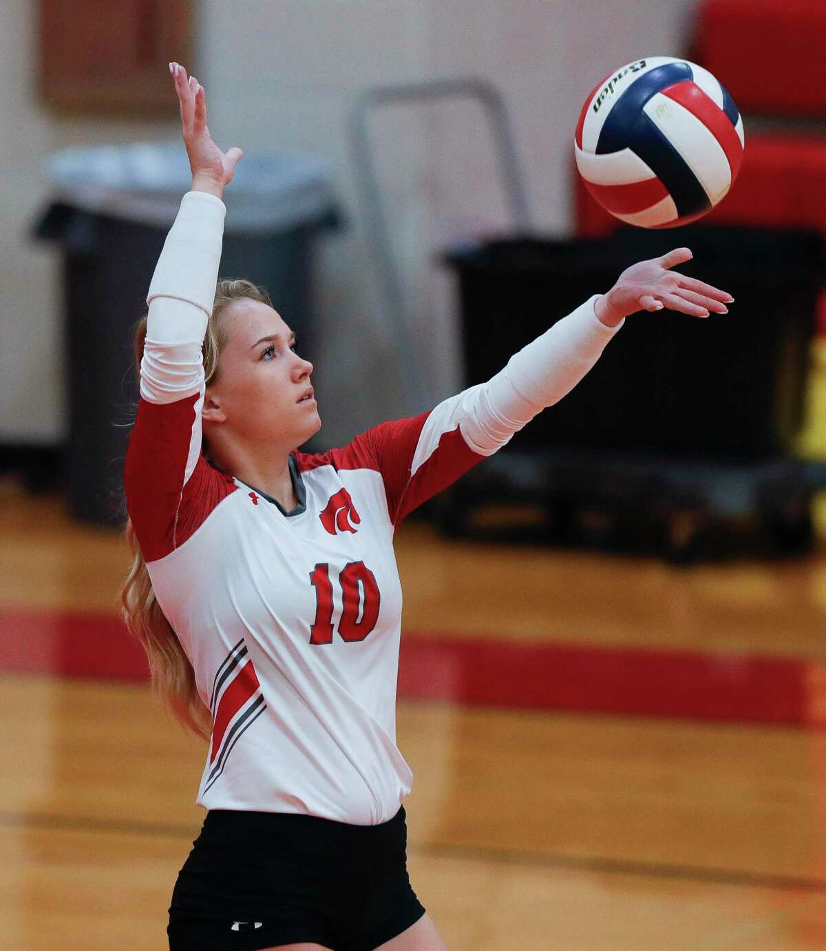 Tori Moore #10 of Splendora serves the ball during the second set of a non-district high school volleyball match, Tuesday, Aug. 11, 2020, in Splendora.