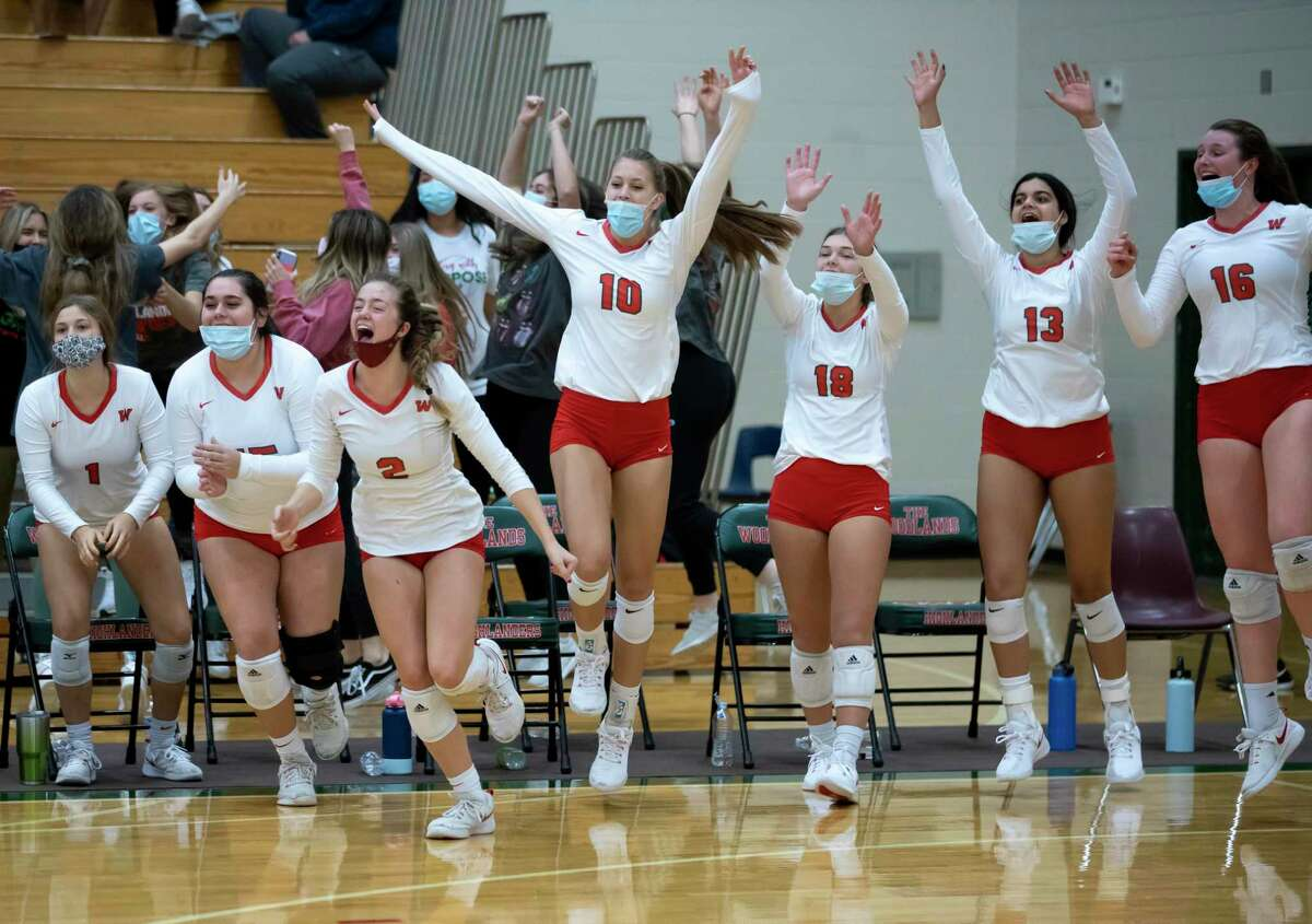 The Woodlands volleyball players run onto the court after they win the fifth set of a Region II-6A quarterfinal volleyball playoff game defeating Klein Cain, landing them in regional tournament, at The Woodlands High School, Saturday, Nov. 28, 2020, in The Woodlands.