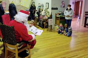 Santa's story event was also was an opportunity to gather nonperishable food pantry donations for the Bear Lake United Methodist Church food pantry. Nonperishable food donations were encouraged at the event with a drop box stationed near Santa's reading chair. (Arielle Breen/News Advocate)