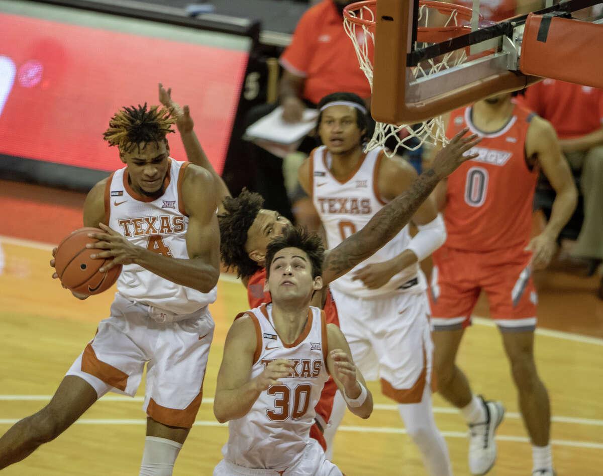 Texas forward Greg Brown (4) pulls down the ball during the second half of the team's NCAA college basketball game against Texas-Rio Grande Valley on Wednesday Nov. 25, 2020, in Austin, Texas. (Ricardo B. Brazziell/Austin American-Statesman via AP)