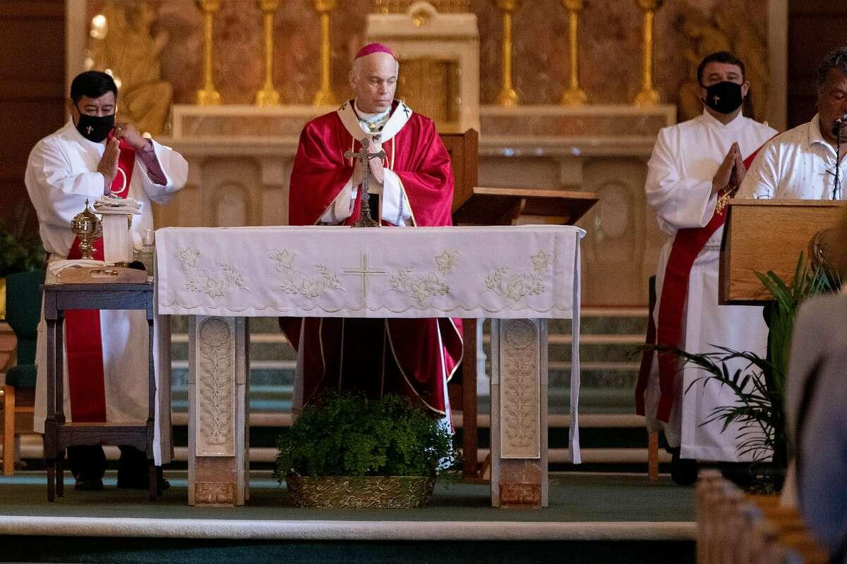San Francisco Archbishop Salvatore Cordileone, shown last month at the Church of Saint Raphael in San Rafael, may sue over new coronavirus restrictions.